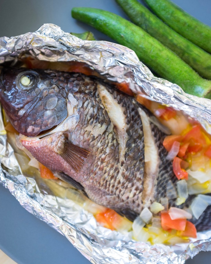 Easy Pinaputok na Tilapia (Filipino Recipe) - Baked Fish in Foil Stuffed with Onions and Tomatoes Recipe | HeyMissLisp.com